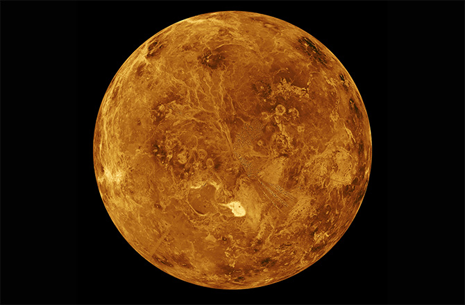 This image shows the surface of the northern hemisphere of Venus as observed by NASA's Magellan radar-mapping spacecraft, which peered through the planet's thick clouds during a mission that ended in 1994. Scientists now suspect Venus may have once harbored oceans of carbon dioxide in the ancient past.