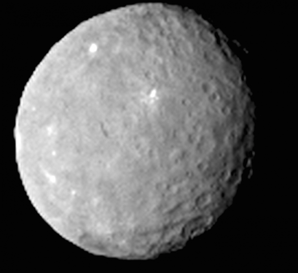 New, sharper images of dwarf planet raise more questions than answers, astronomers say. Scientists eagerly await the arrival of the Dawn spacecraft at Ceres in March.