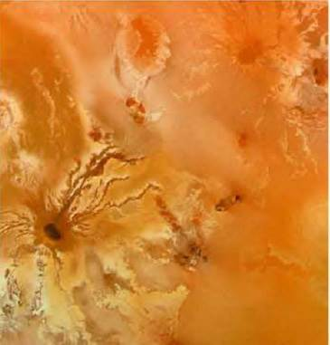 Volcanic Eruptions On Io: Lava flows out of a dark vent (lower left) in this lo image from Voyager 1